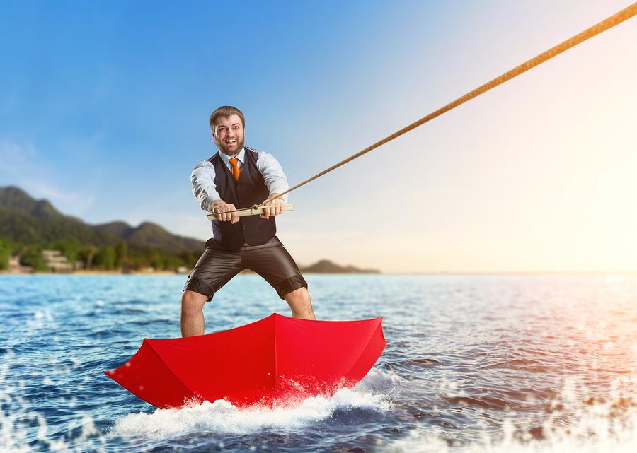 bigstock-Businessman-on-water-skis-in-u